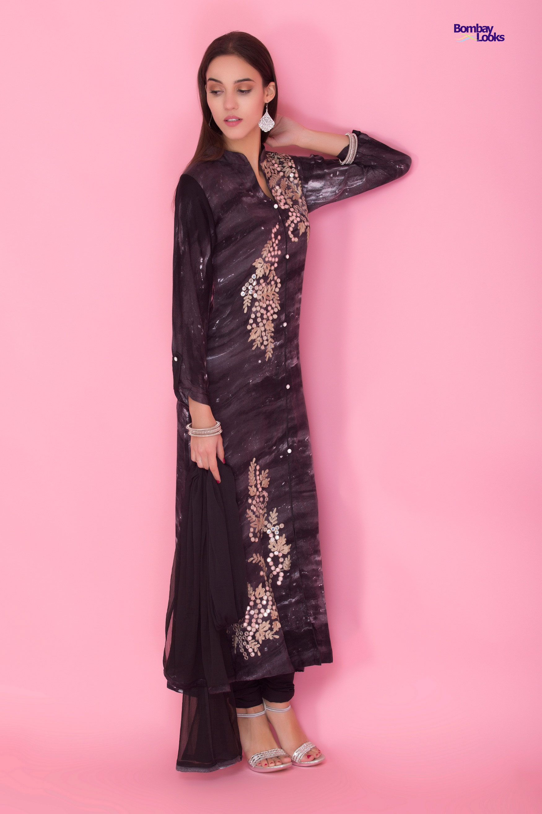 Semiformal longline suit in black with rich golden embroidery and stone work
