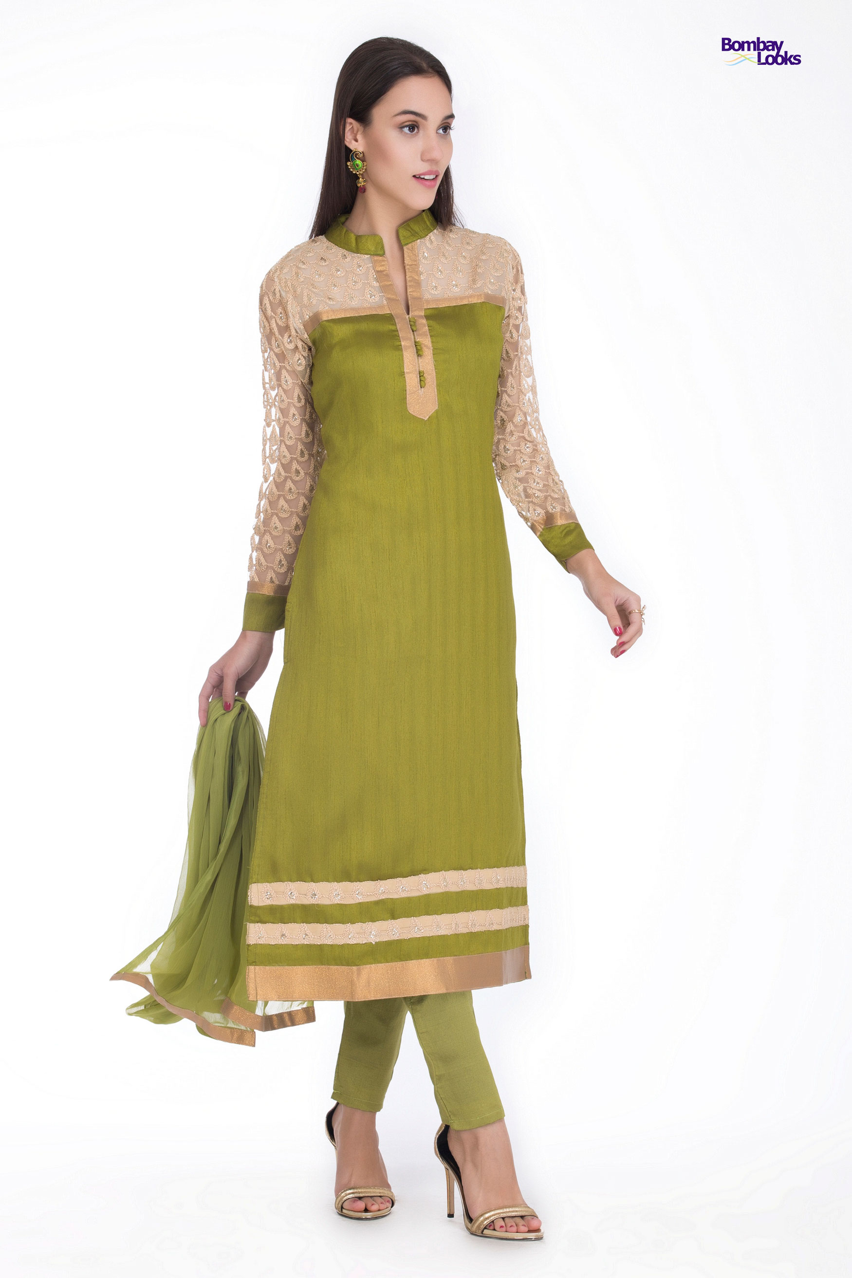 Smart green dupion silk spring suit with lace embroidery on sleeves and bodice