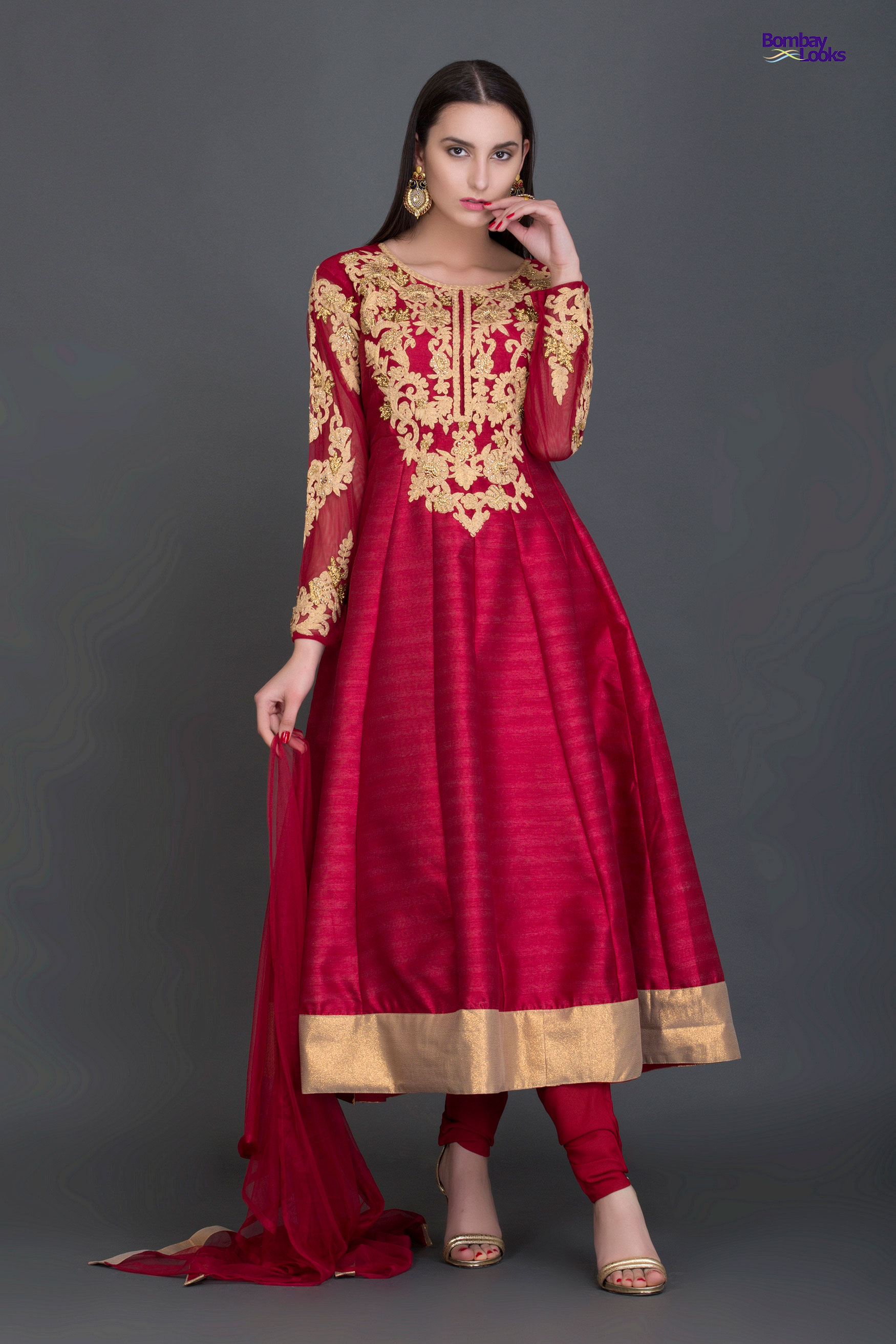Gorgeous royal anarkali red suit with rich golden embroidery