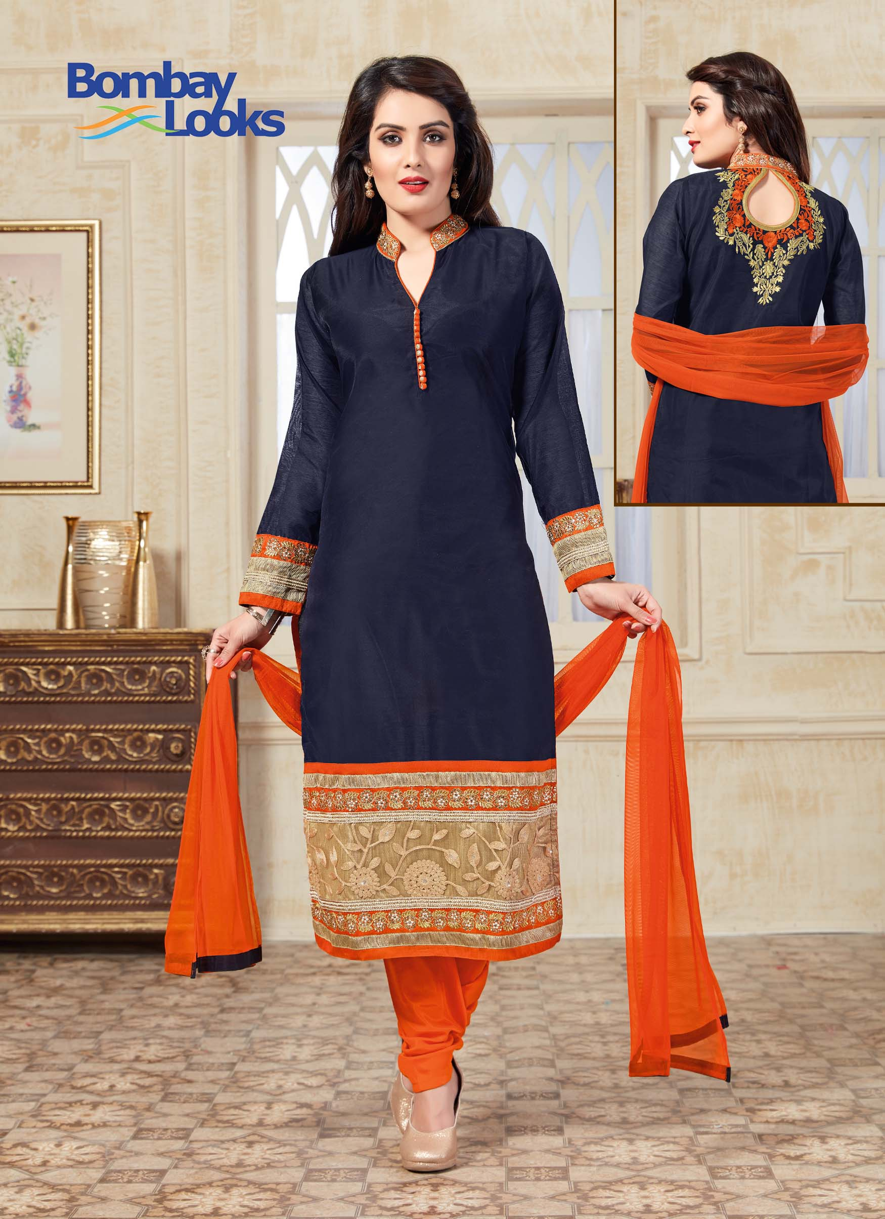 Elegant contrasting suit in navy and orange and rich golden dabka embroidery