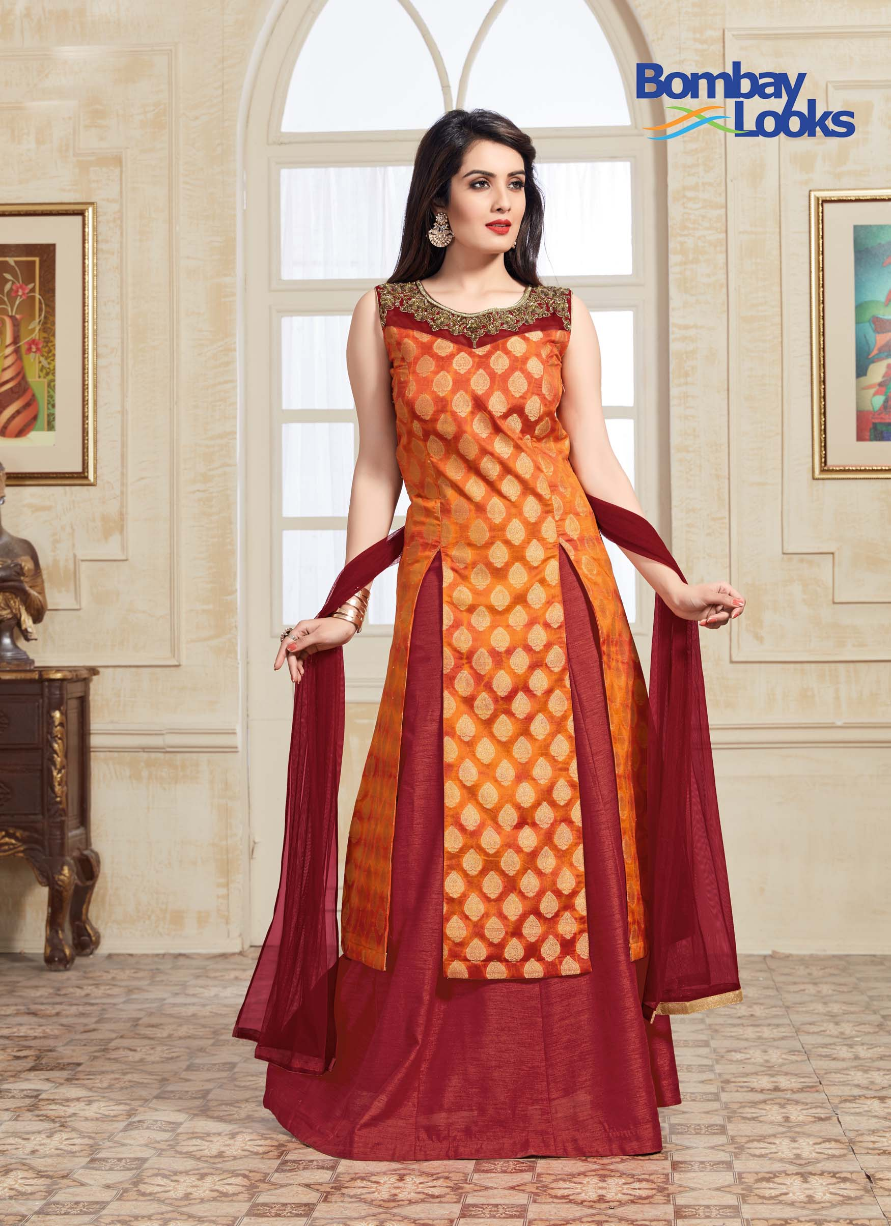 Vibrant split styled kurta in orange with golden brocade lehenga and pencil trousers