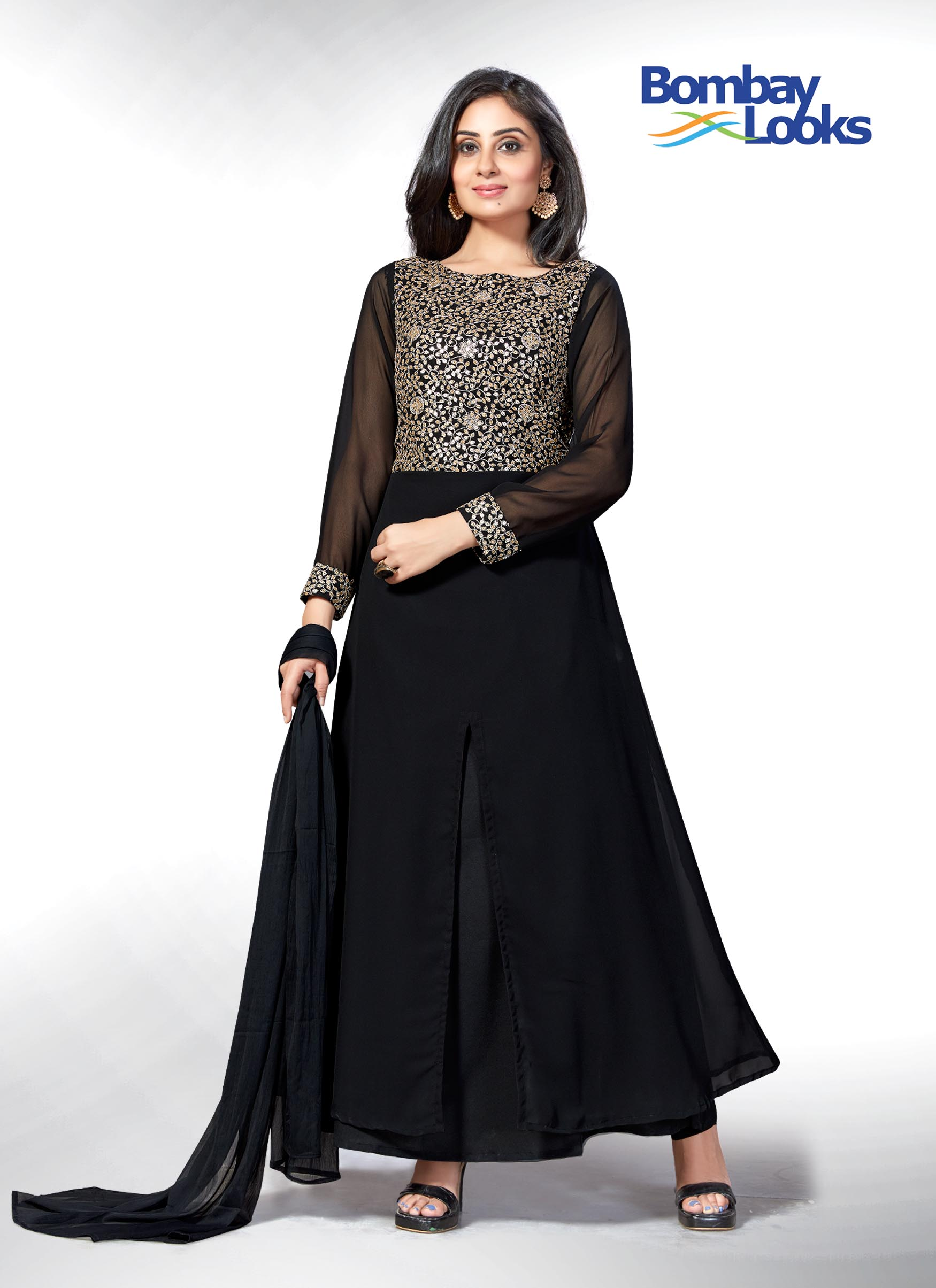 Glamorous layered black anarkali style suit with rich embroidery on the bodice and front slit