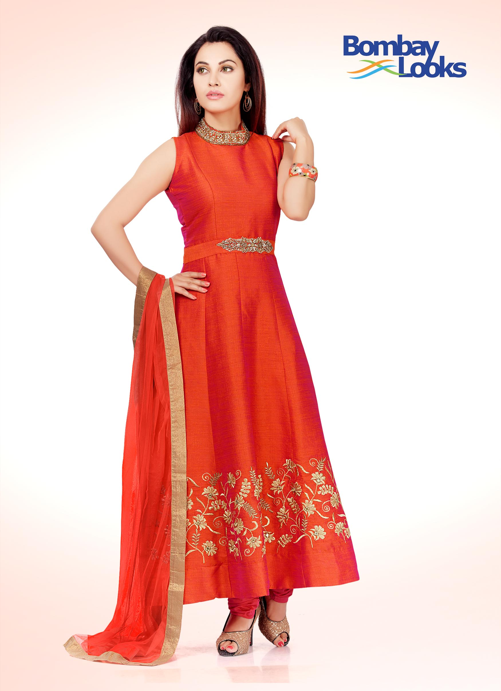 Gorgeous coral anarkali suit with a elegant embroidery on neck  and waist and  gold embroidery on the skirt.