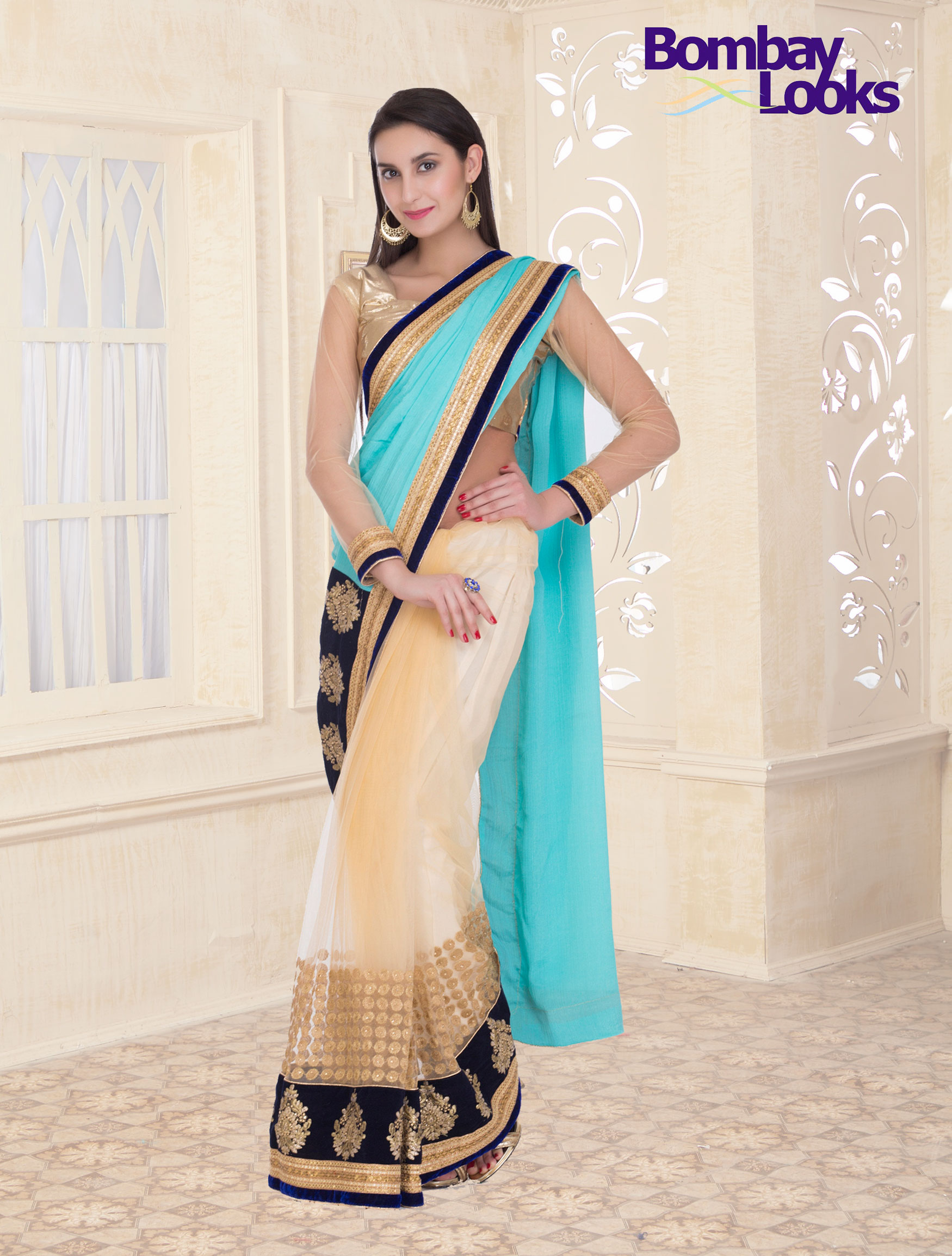 Gorgeous soft net half anf half saree with sky blue body and shiny net blouse