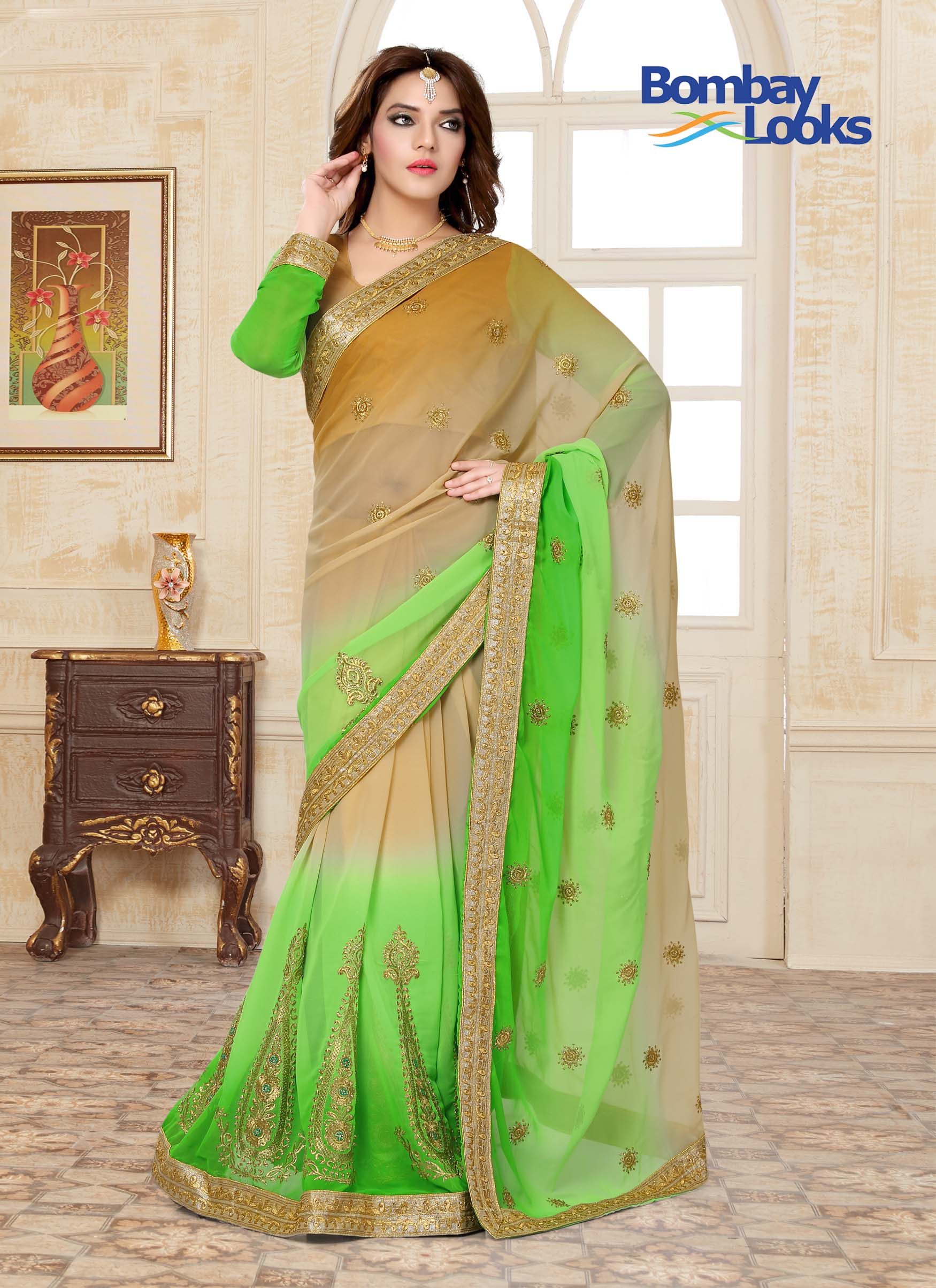 Beautiful ombre shaded georgette saree in caramel and soft green with golden embroidry and full sleeved blouse