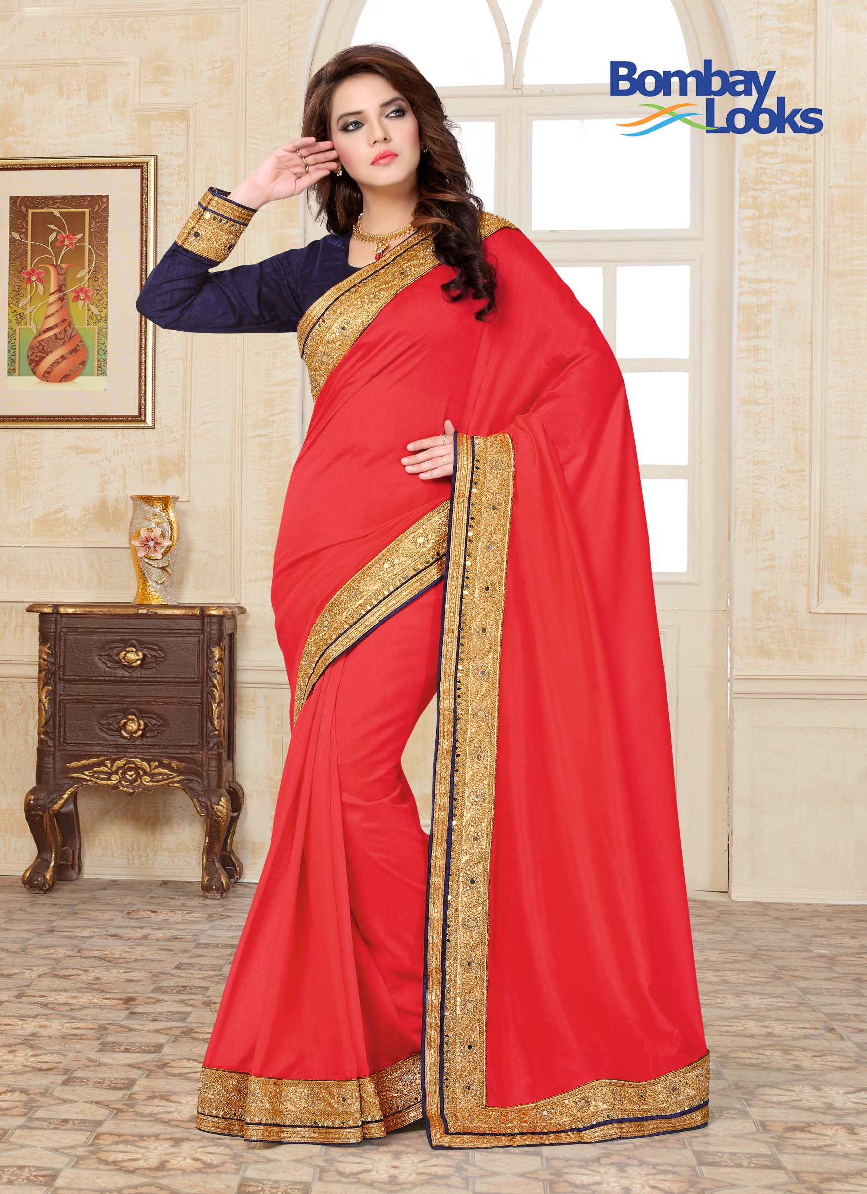 Rich gala crepe saree in red with contrasting full sleeved blouse and mirrored rich golden embroidered border