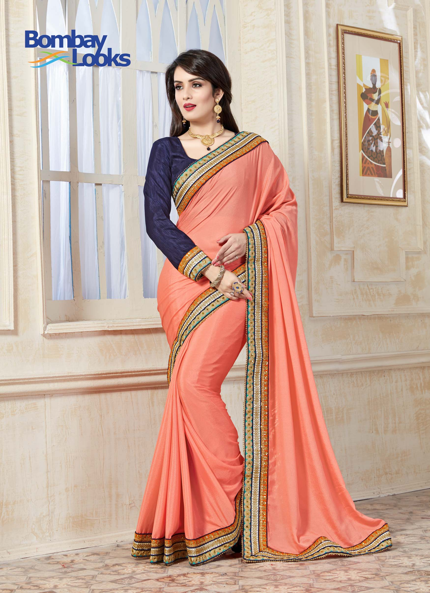 Delicate peach crepe saree with navy blue full sleeved blouse and bright borders