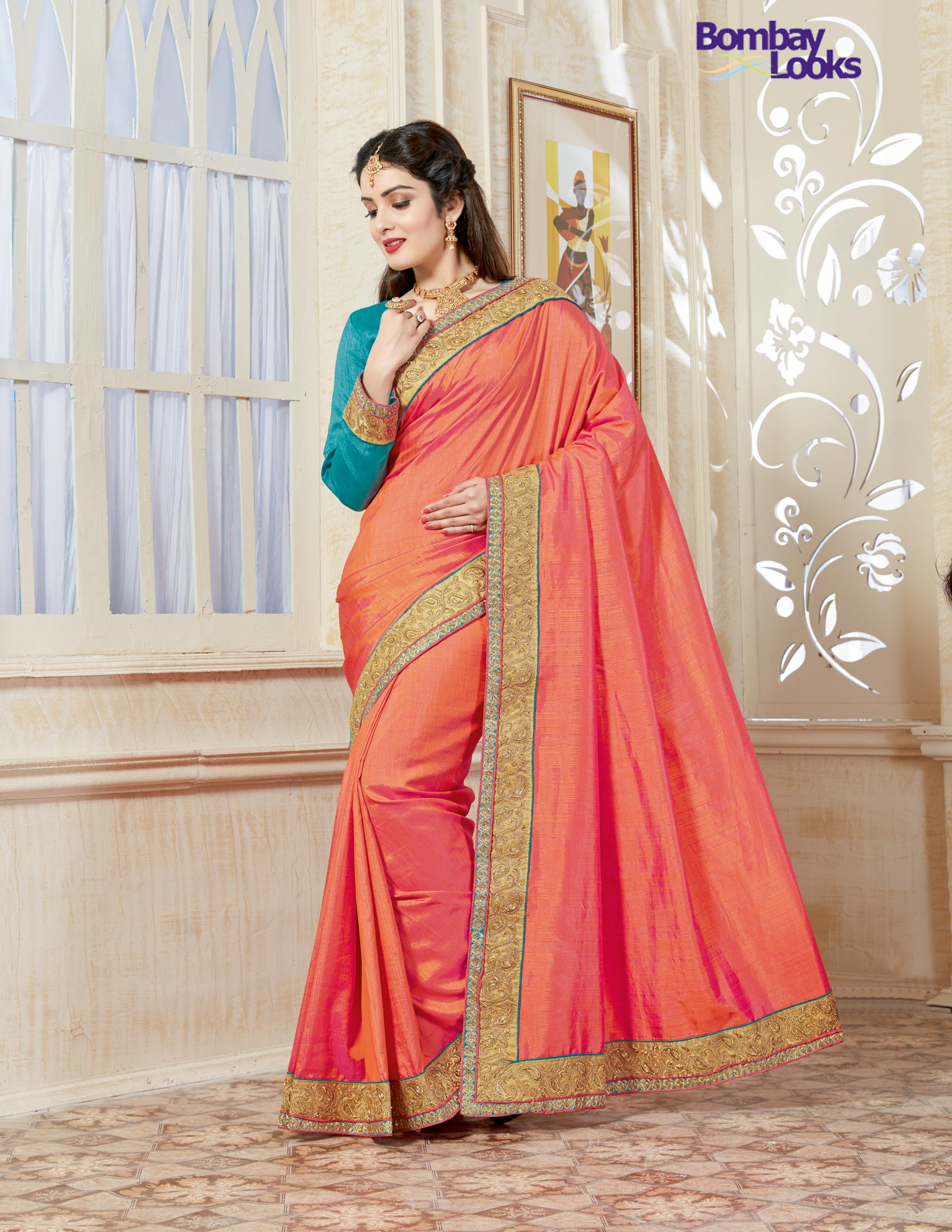 Soft peach and turqouise green dual tone saree with golden borders and full sleeved blouse
