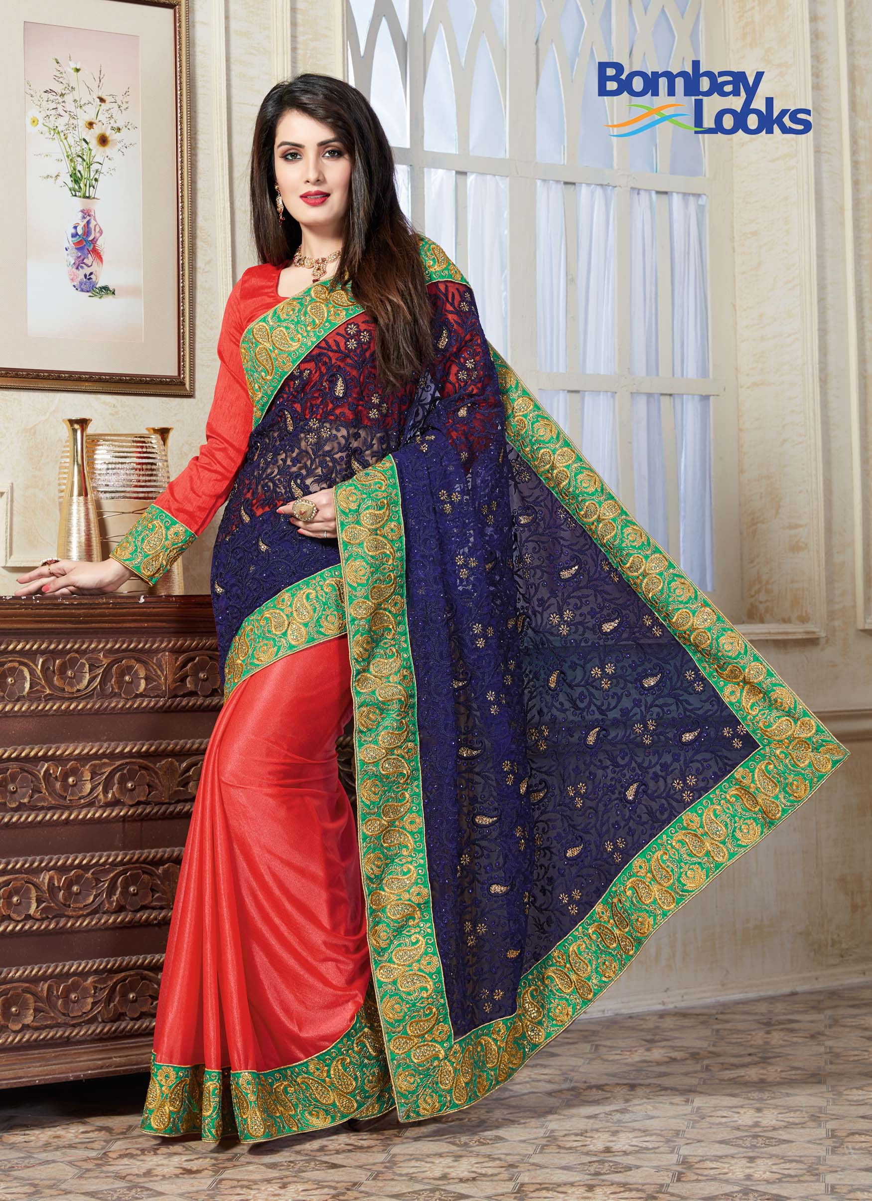 Gorgeous navy blue, green and coral saree with rich embroidery and stone cut work