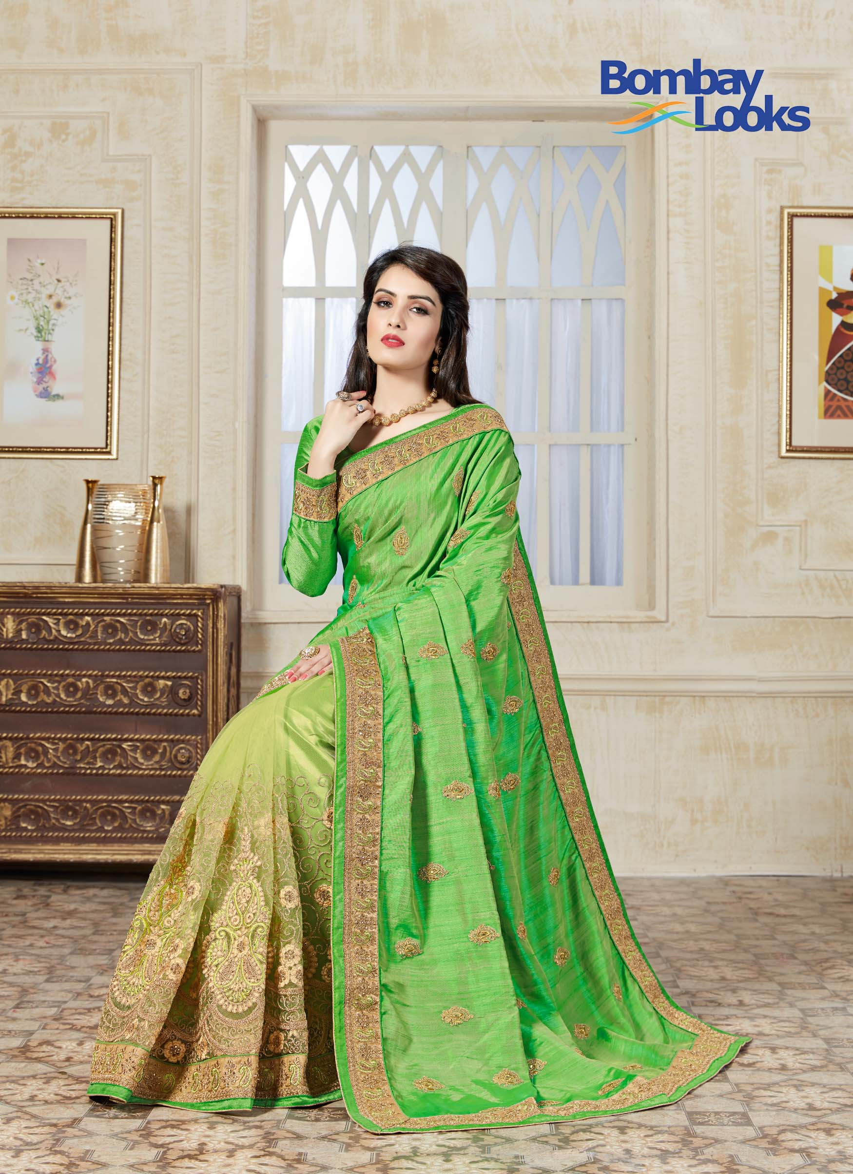 Elegant sea grean soft net half and half saree with gold embroidered skirt
