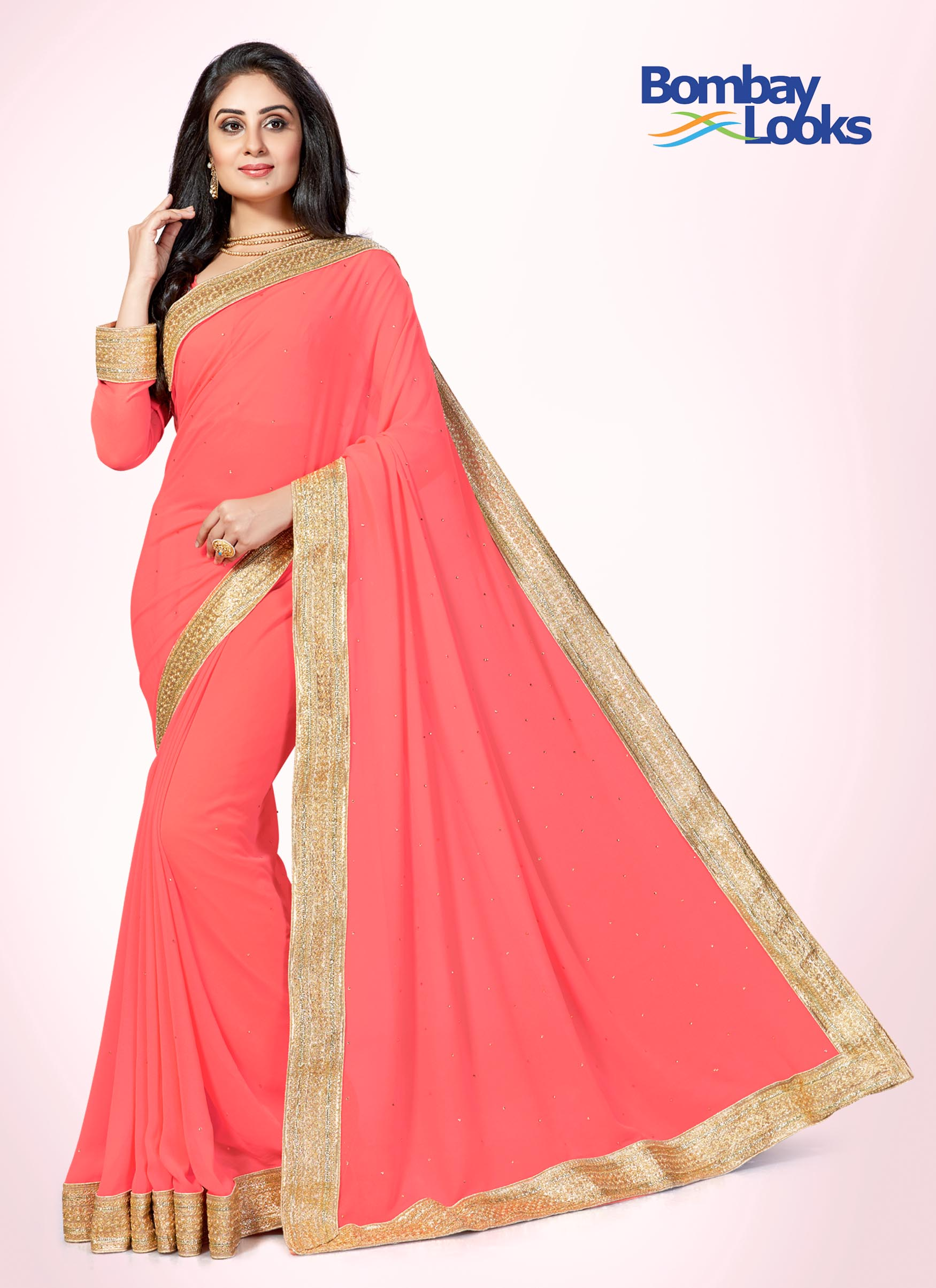 Flirty pink georgette saree with embroidered gold border