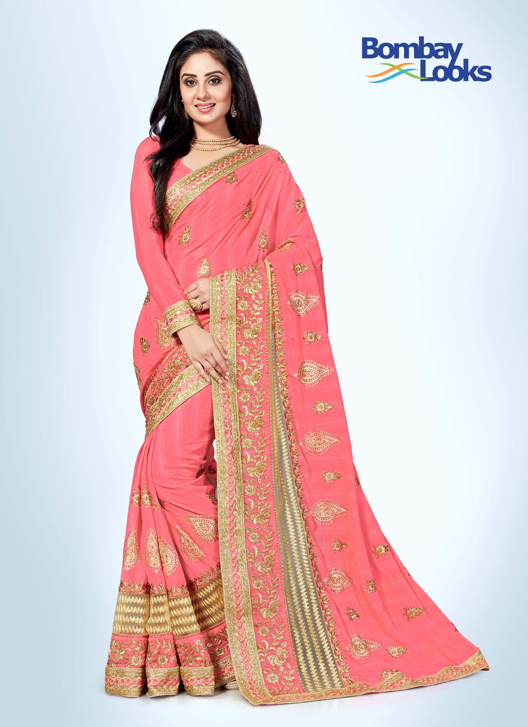 Candy floss pink saree with heavy gold embroidery