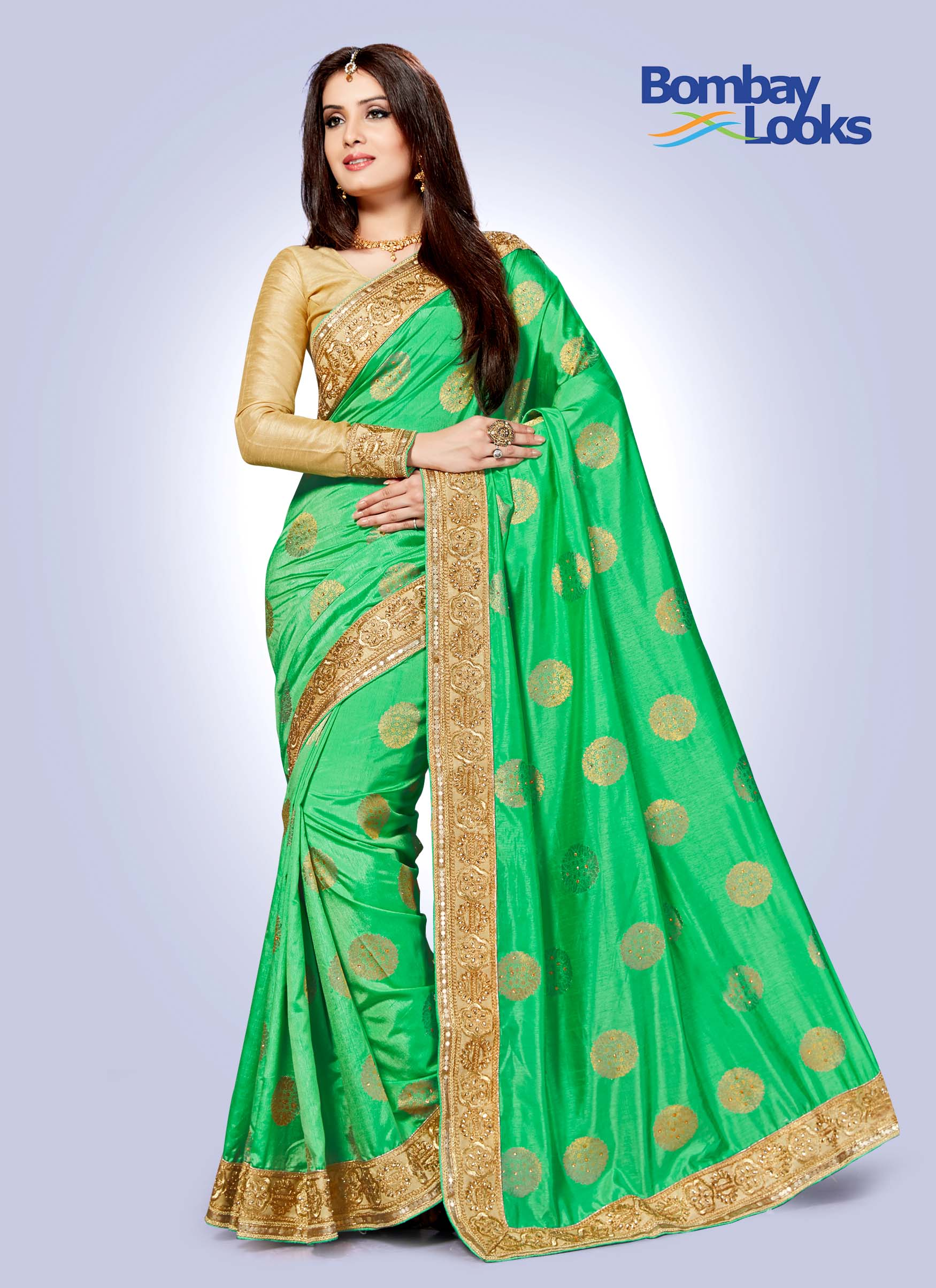 Light green butta saree with chikoo gold border