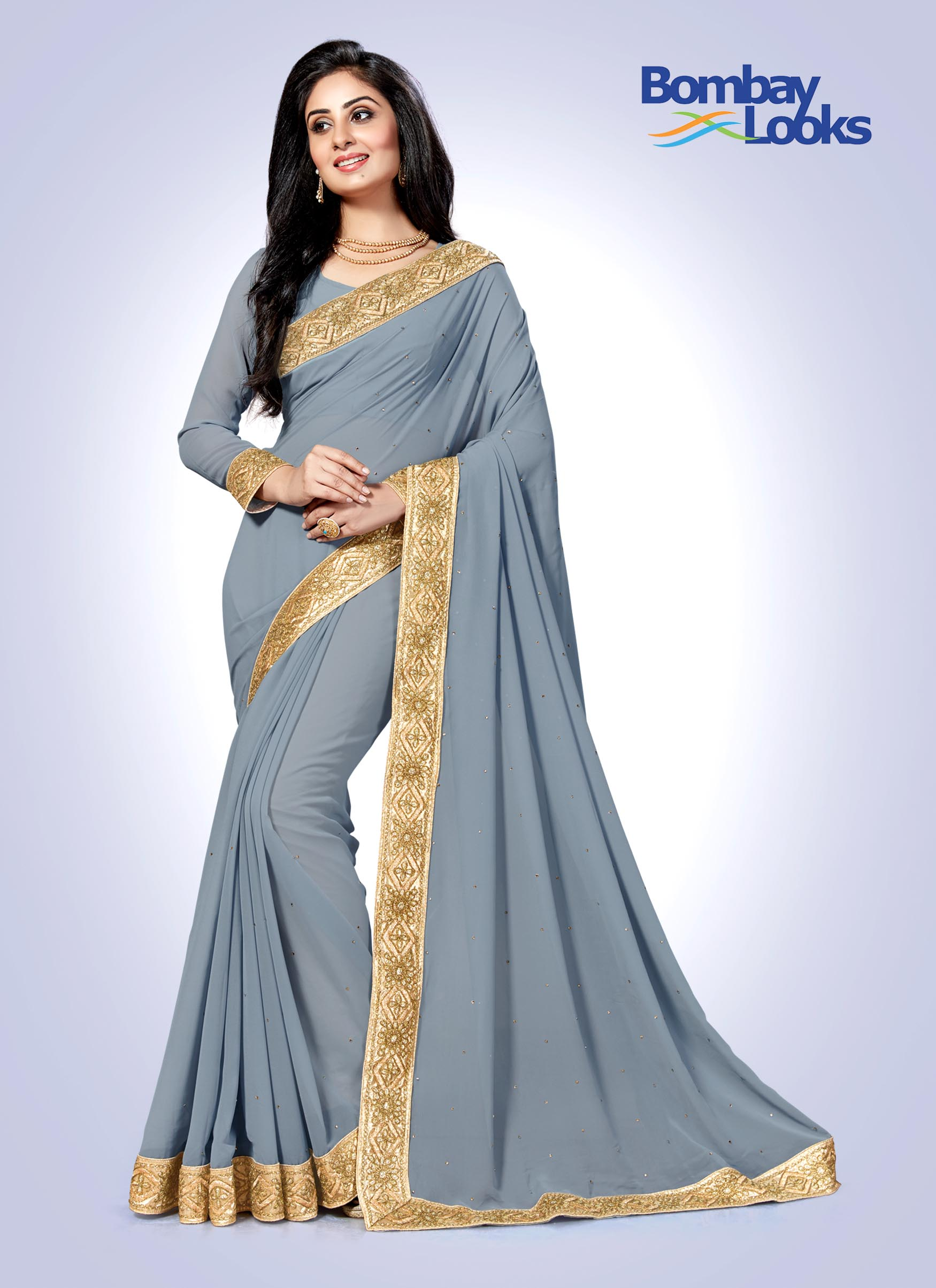 Elegant grey georgette saree with rich gold border