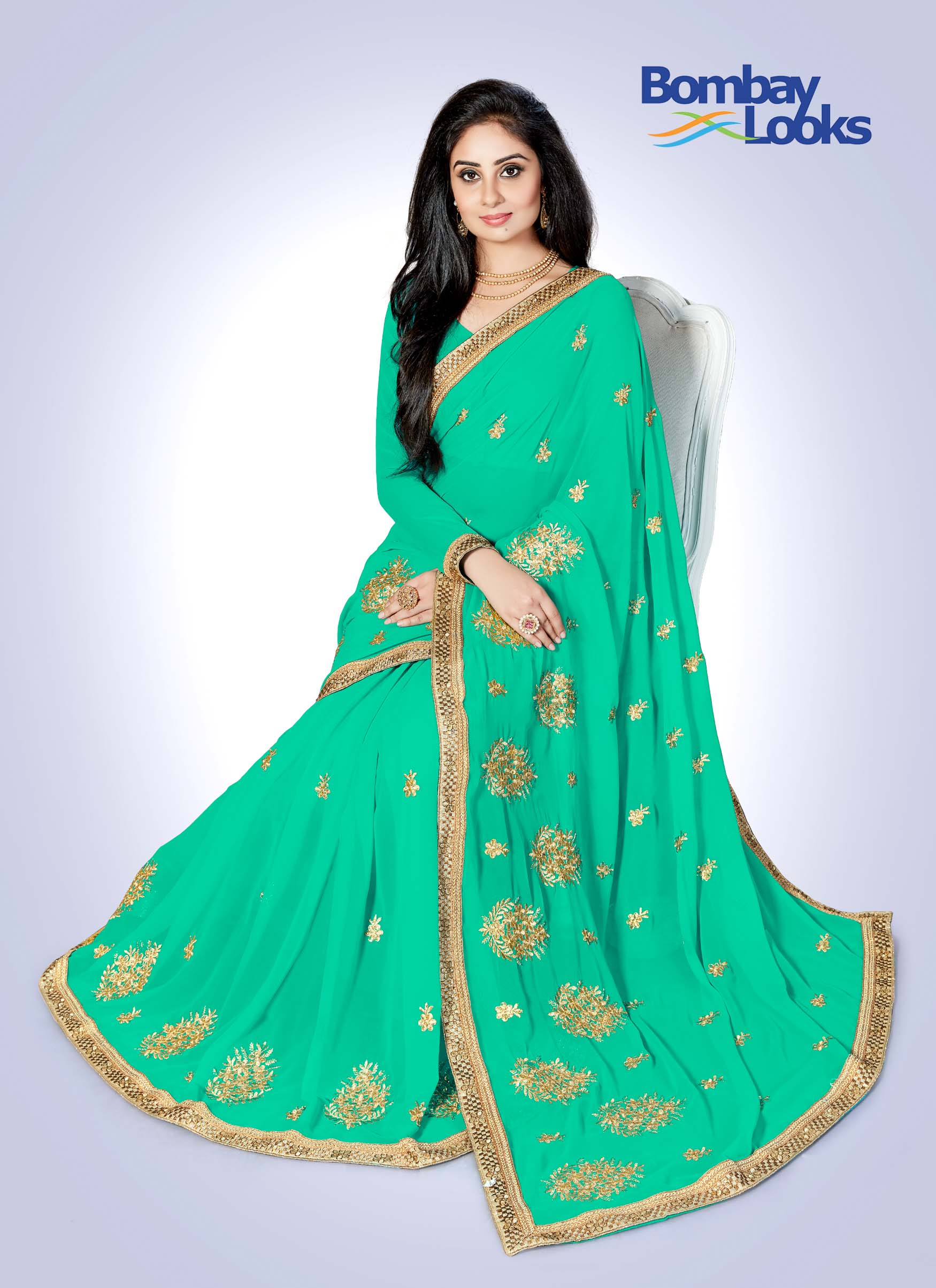 Green georgette saree with gold embroidery