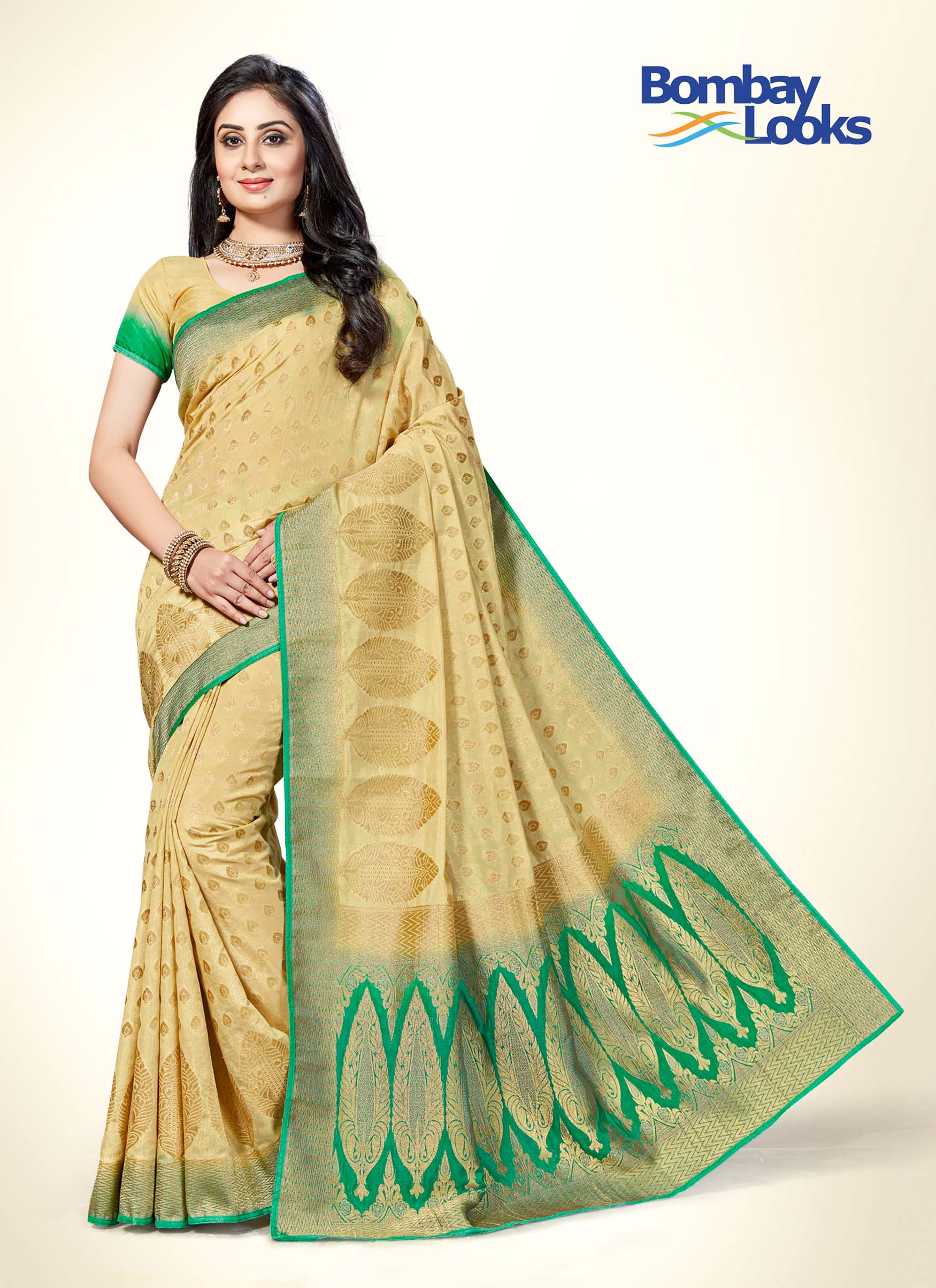 Elegant Gold and Rama shaded saree with intricate gold embroidery