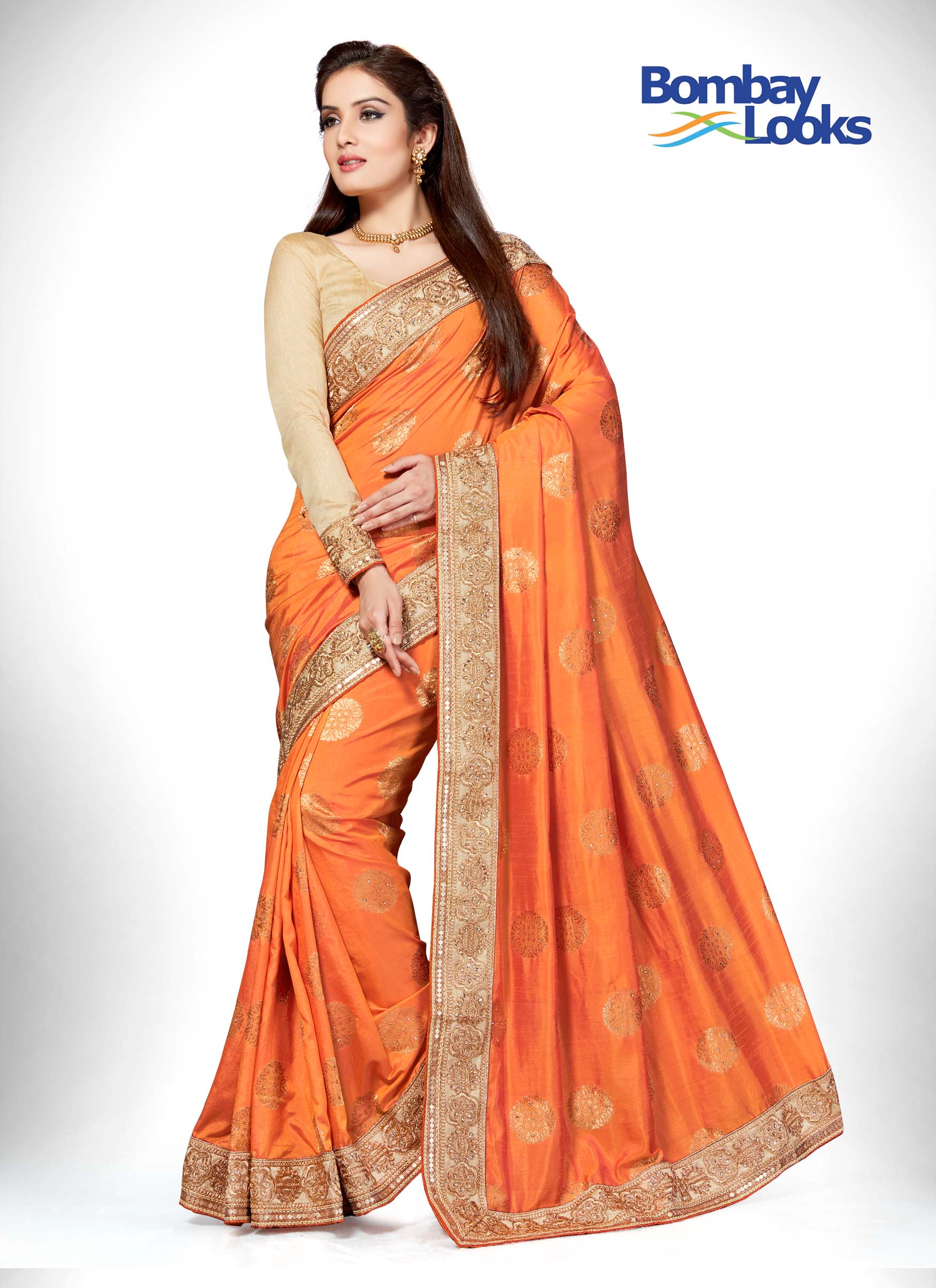Orange banarasi butta saree with gold stone border