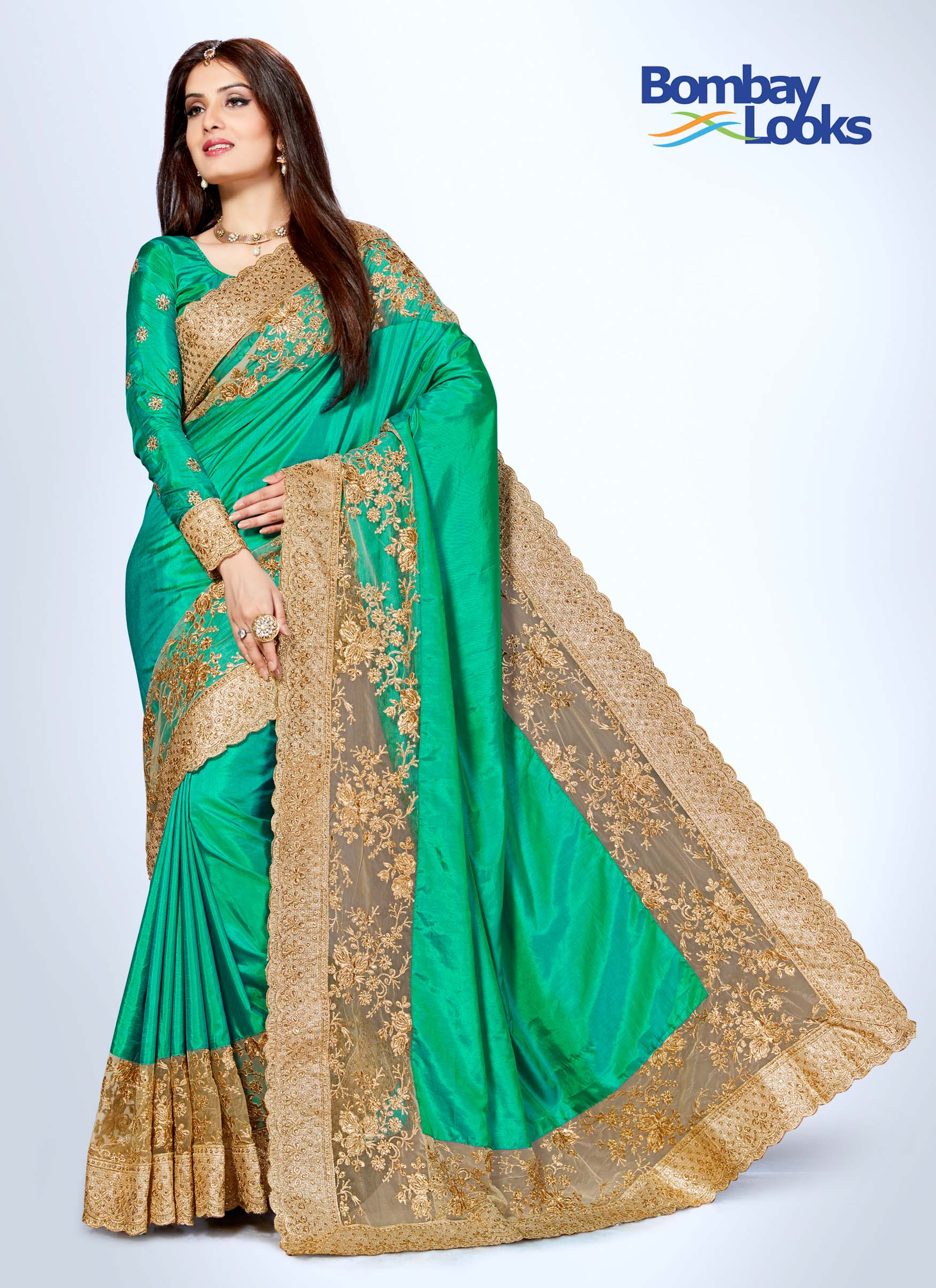 Rama green soft silk saree with broad embroidered border