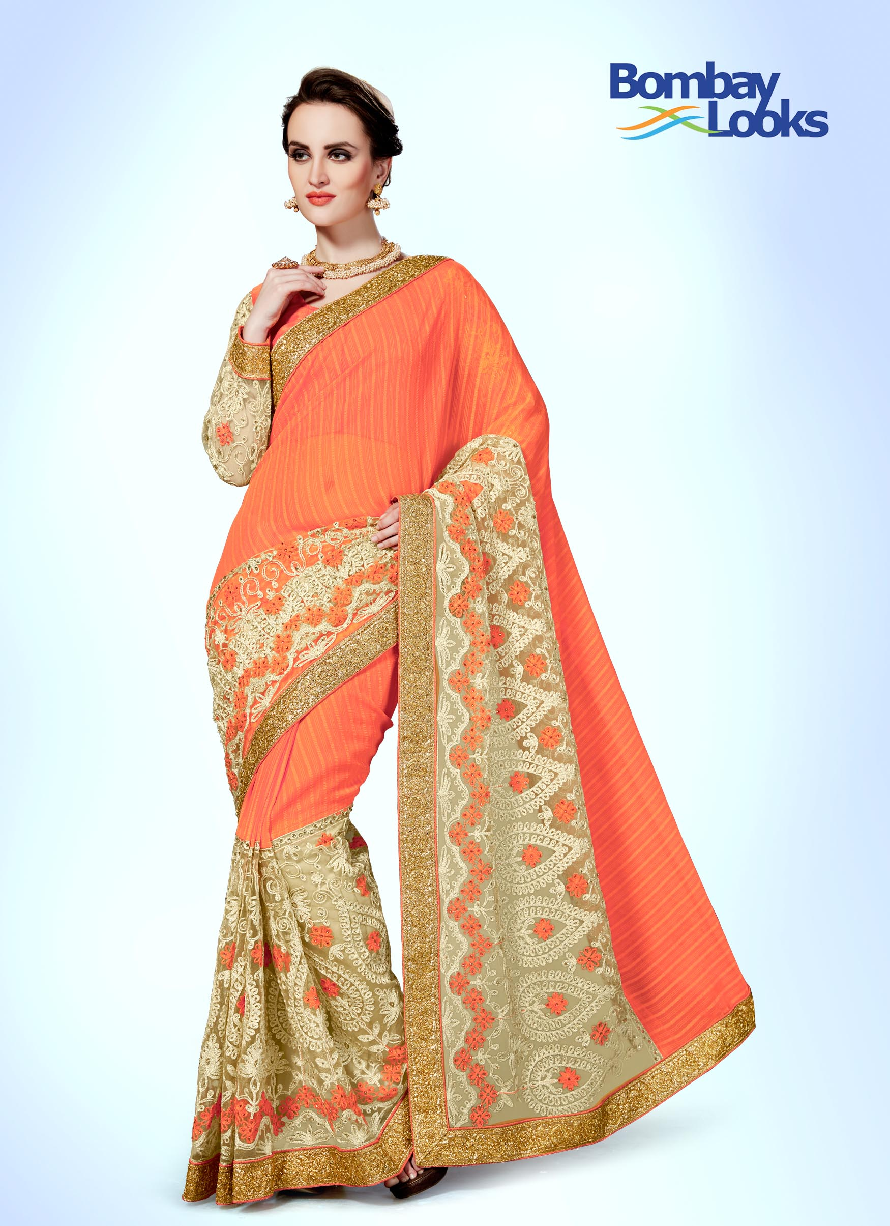 Peachy orange saree with heavy skirt embroidery