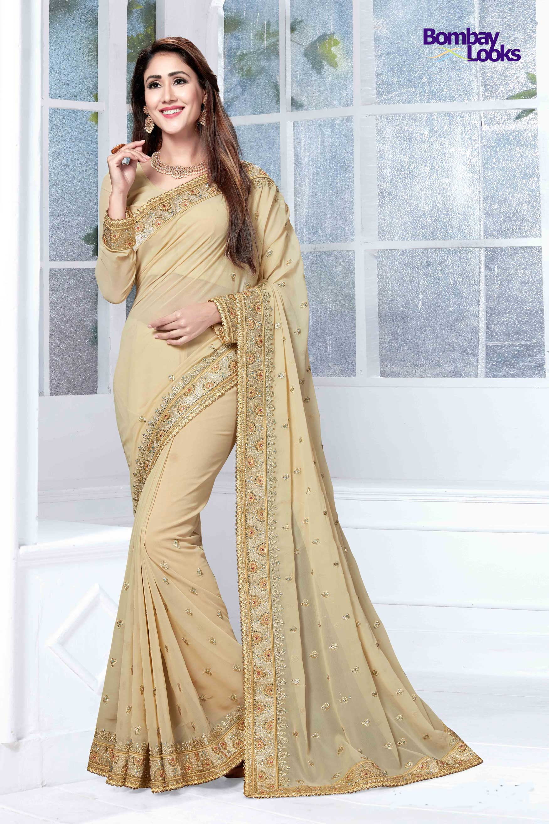 Beige Georgette saree with heavy gold embroidery