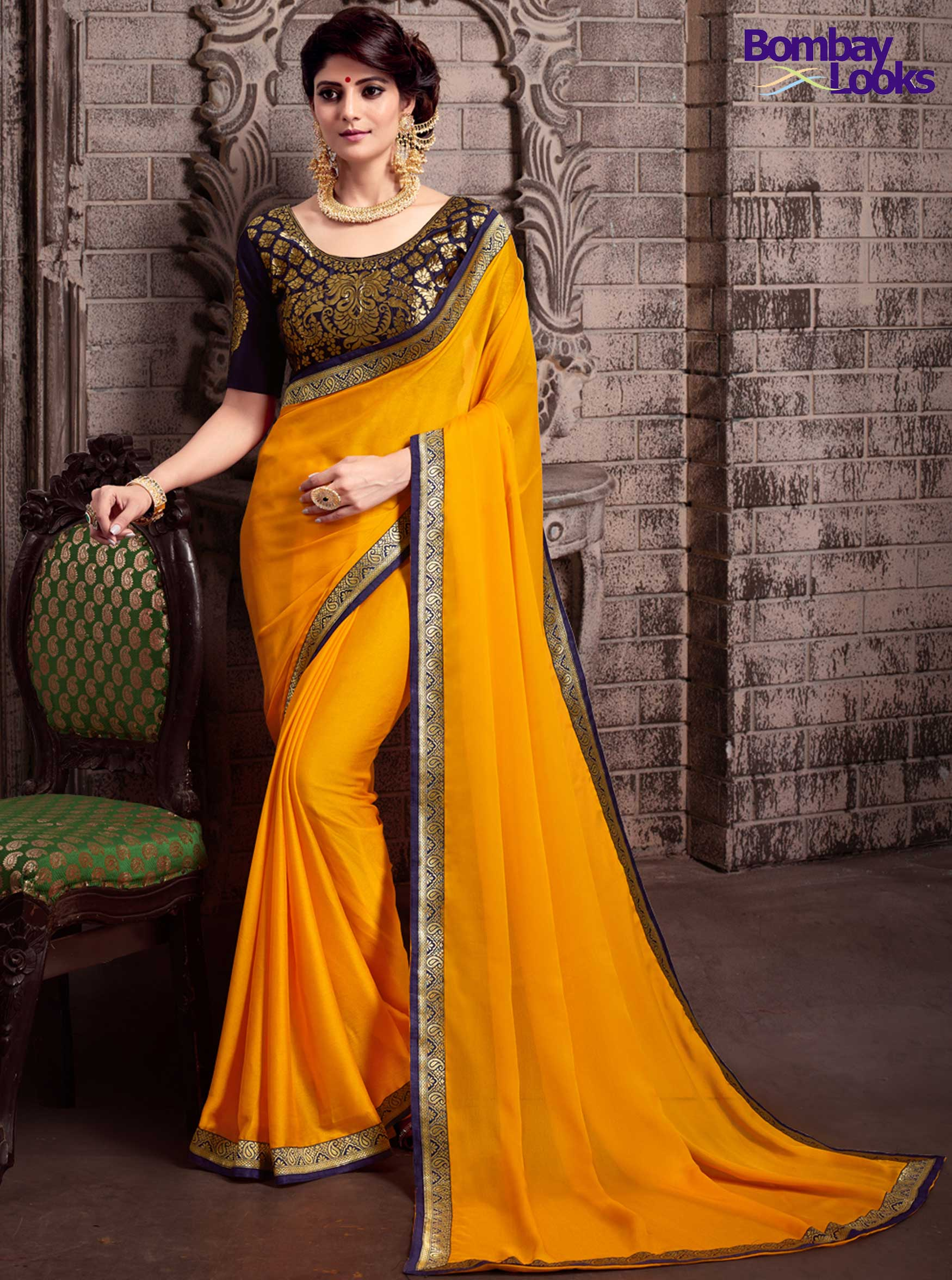 Gorgeous Saffron chiffon saree with brocade blouse