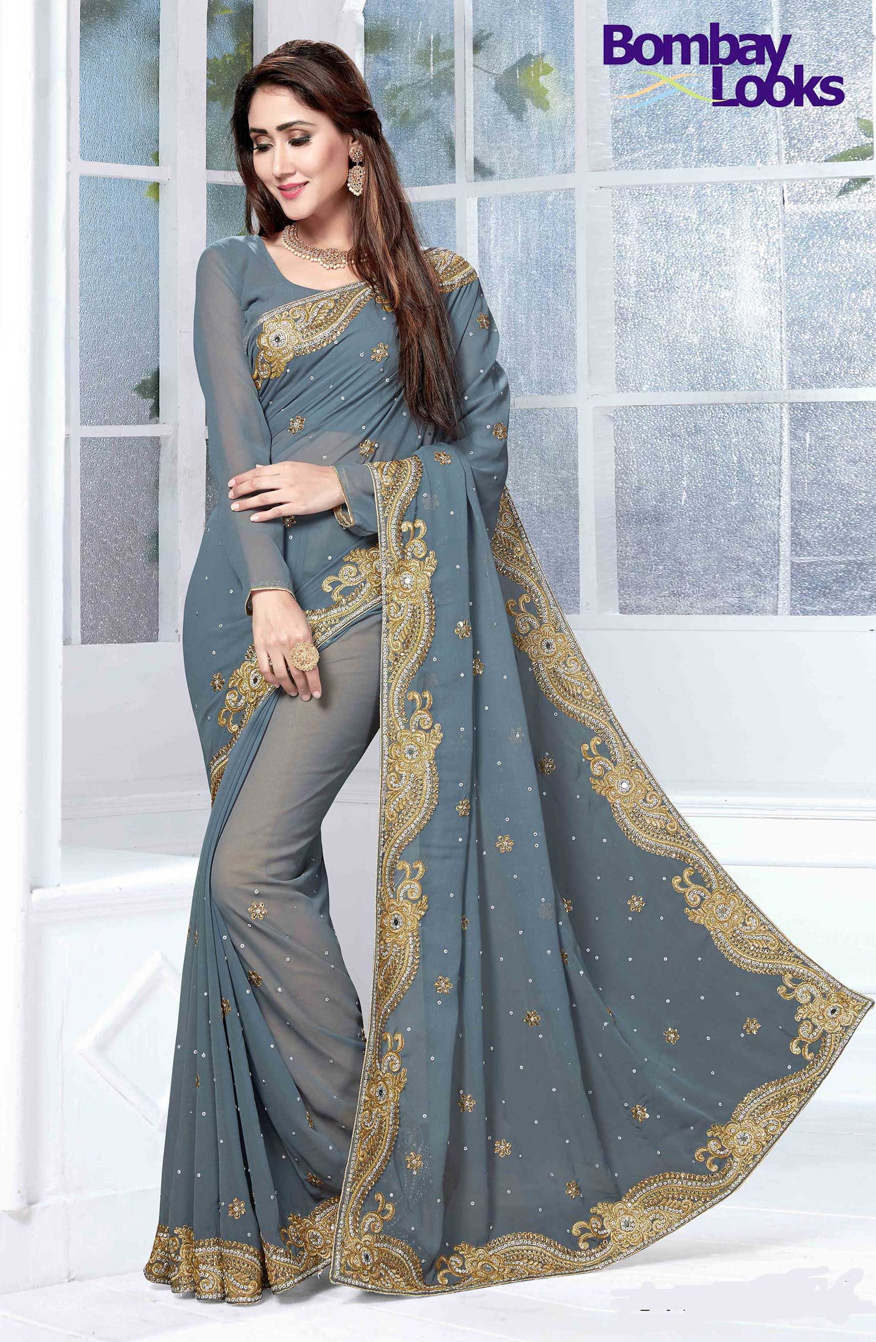 Grey Georgette saree with heavy gold embroidery border
