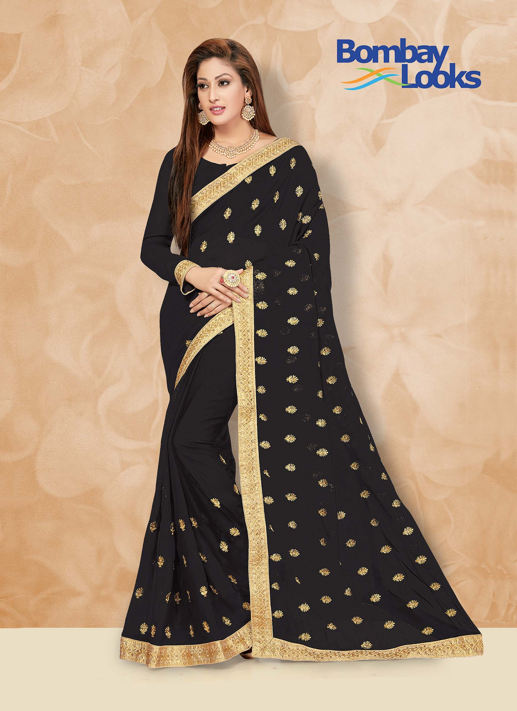 Soft Georgette black saree with elegant gold border
