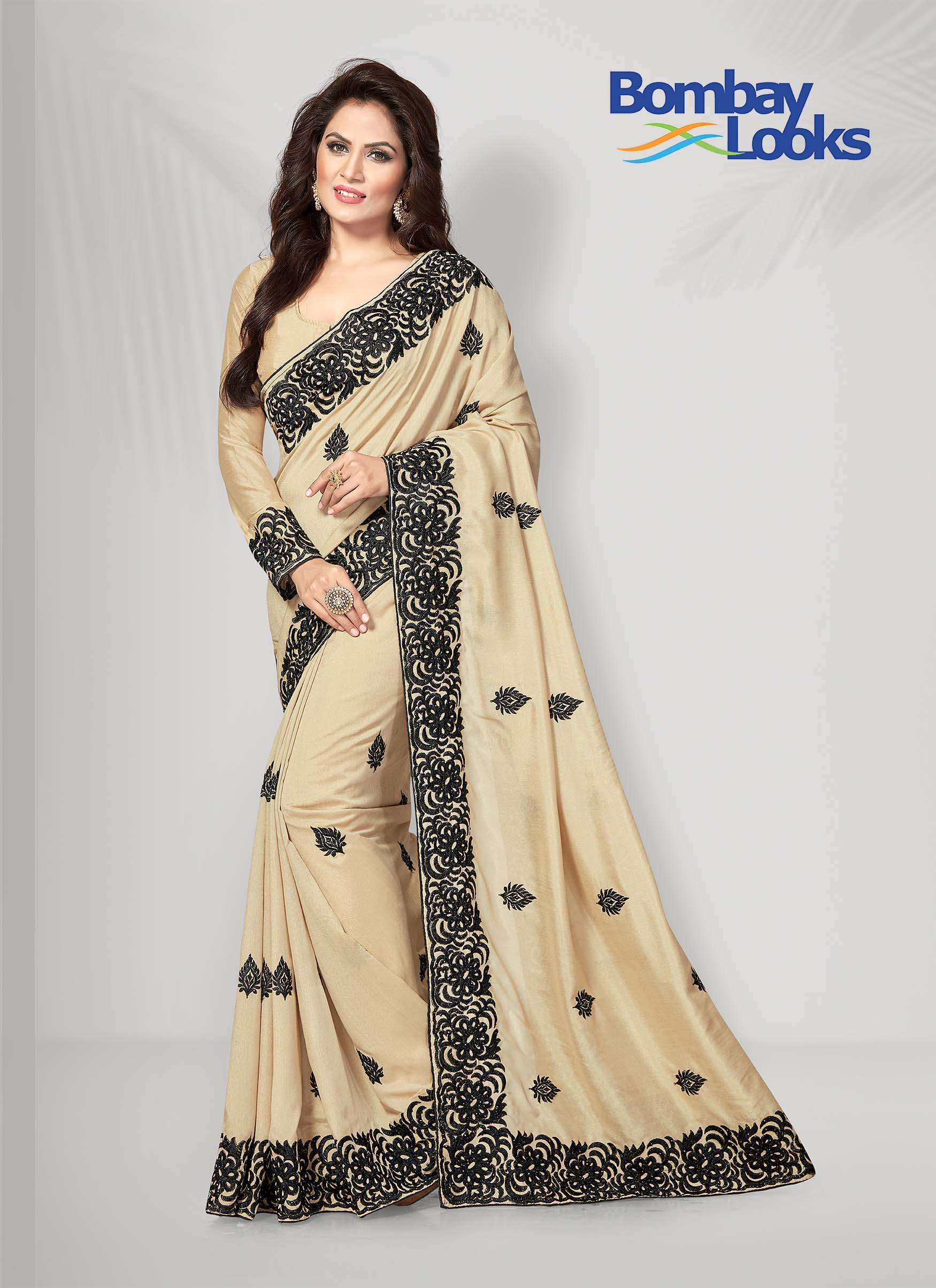 Biscuit colour soft silk saree with black embroidery