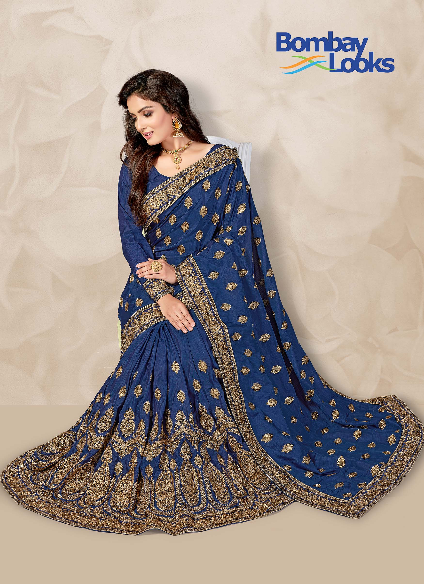 Royal blue silk saree with gorgeous embellishments in gold