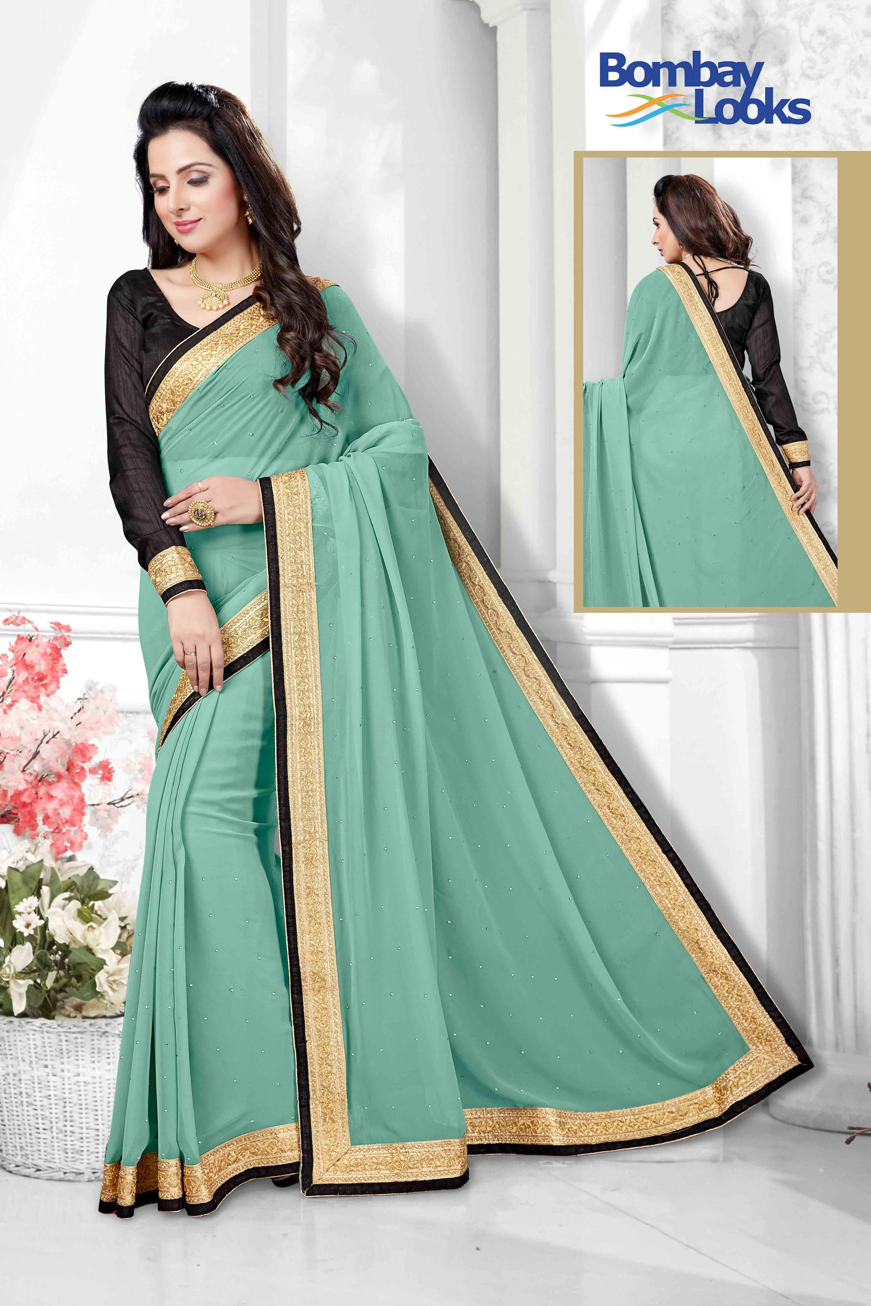 Classic jade georgette saree with elegant gold border
