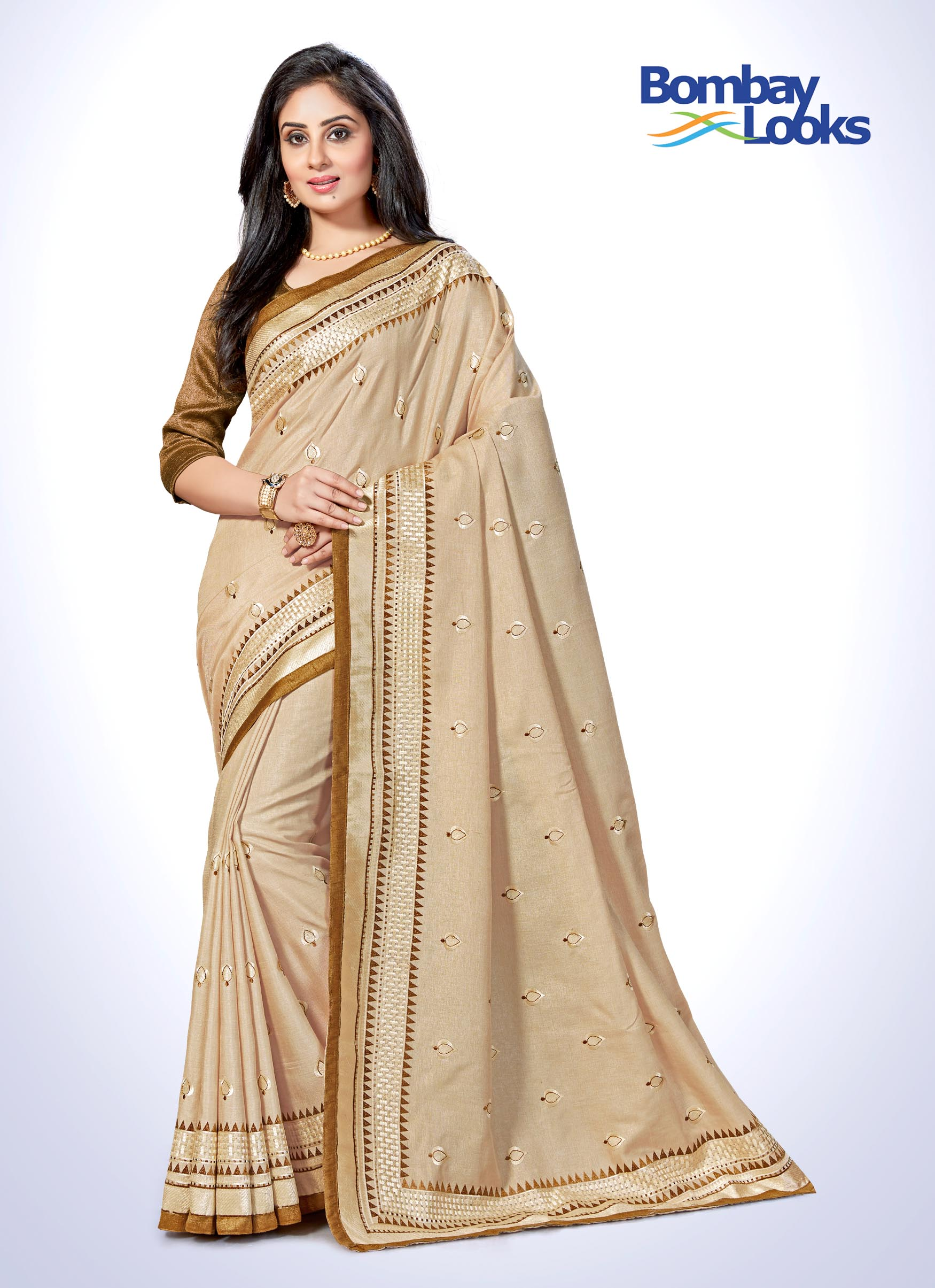 Elegant earthy beige silk saree with rich resham embroidery and  brownish golden border.