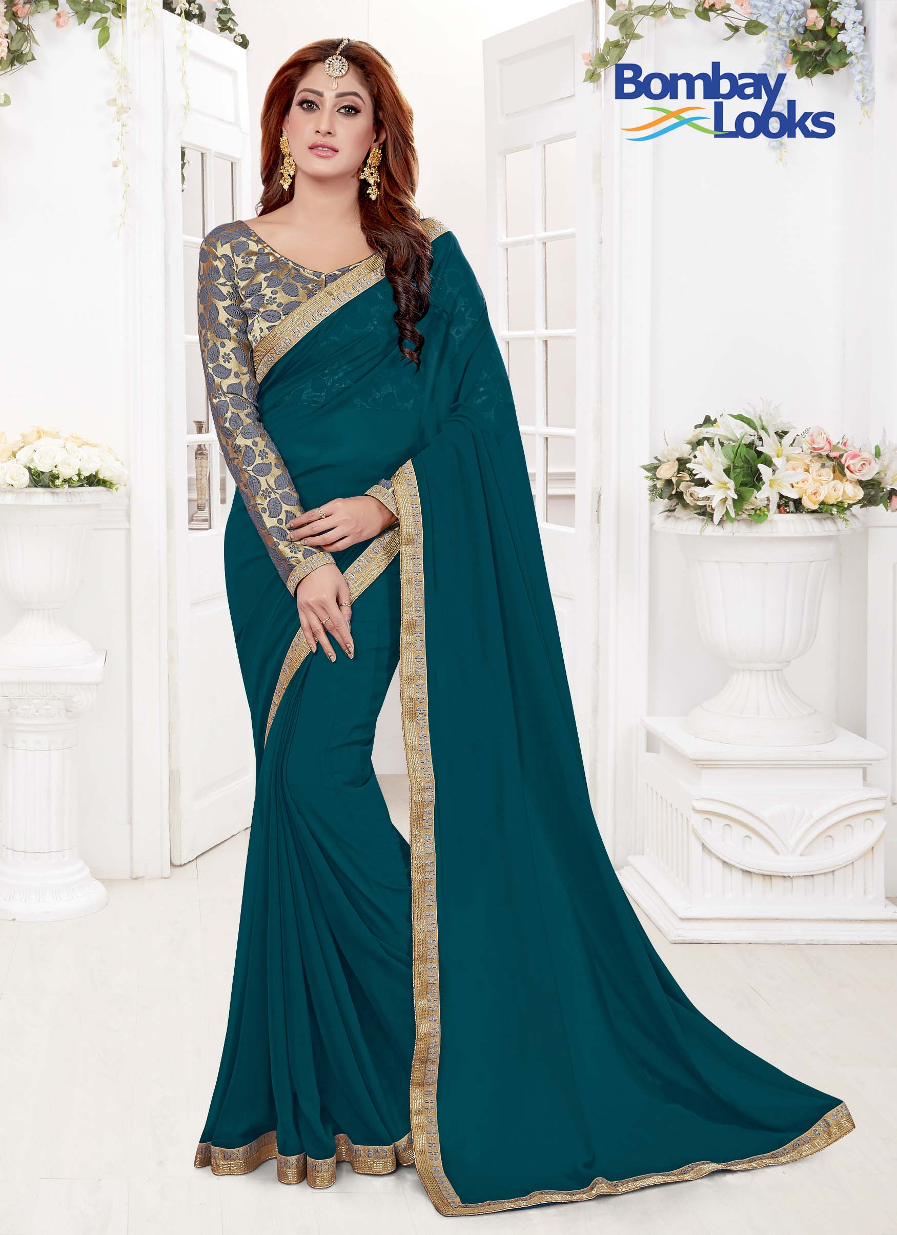 Pretty Teal colour saree with dainty gold border