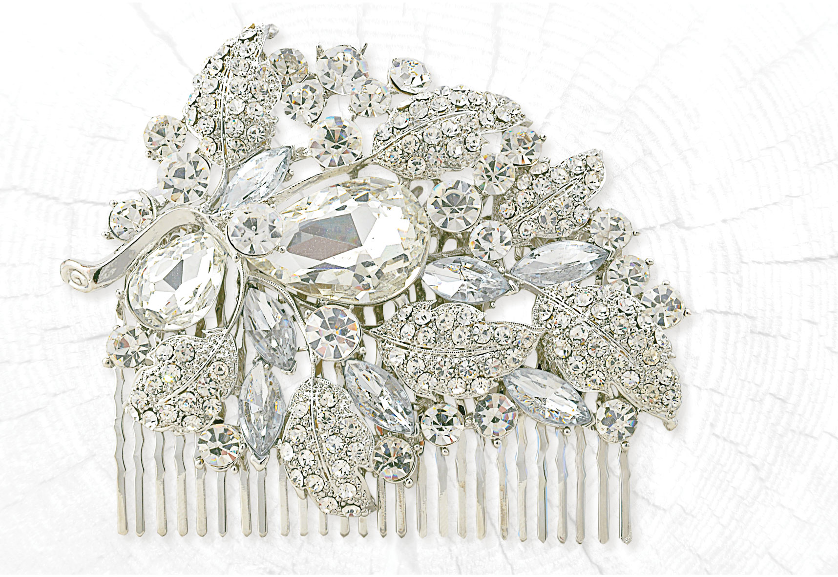 Rich floral silver diamante hair comb in antique finish